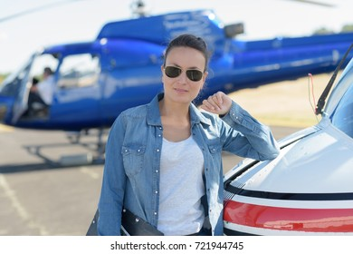 young beautiful woman helicopter pilot