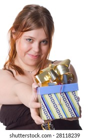 young beautiful woman holding gift box (over white)