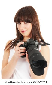 Young beautiful woman holding a photo camera. White background