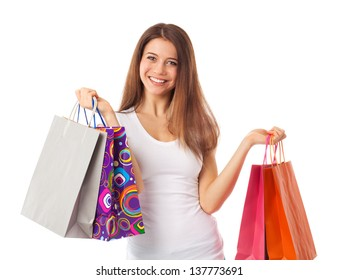 Young beautiful woman holding shopping bags, isolated on white