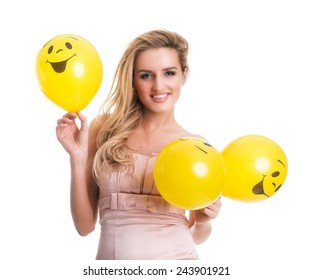 Young beautiful woman holding yellow smiley balloons, valentine's day, isolated