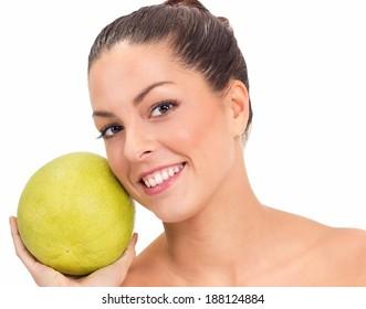 young beautiful woman holdinga big grapefruit on her face