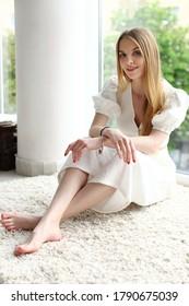 Young beautiful woman at home looking at the camera.