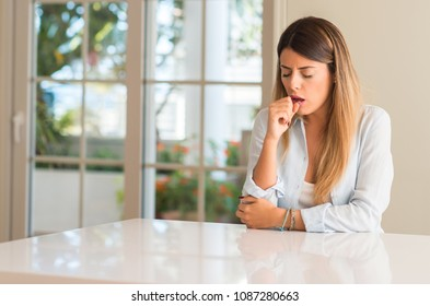 Young beautiful woman at home sick and coughing, suffering asthma or bronchitis, medicine concept