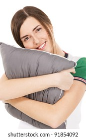 Young beautiful woman hugging a pillow, isolated on white background