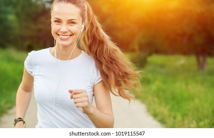 Young beautiful woman jogging workout training