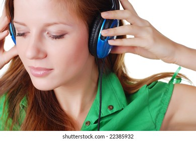young beautiful woman listening music with headpfones