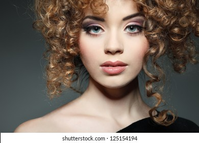 Young beautiful woman with long curly hairs