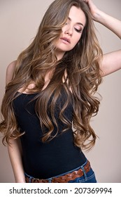 young beautiful woman with long curly hair