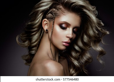 Young beautiful woman with long curly hairs and colored make up