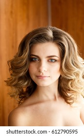 young beautiful woman with long curly hair closeup