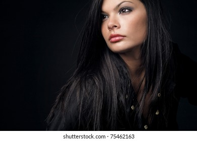 Young beautiful woman with long dark hair.