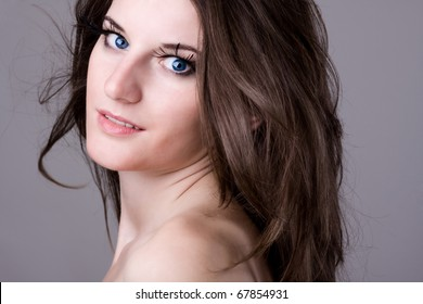 young beautiful woman looking directly in camera