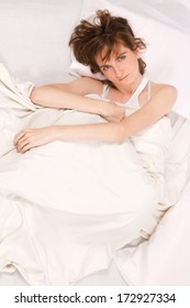 Young beautiful woman lying on the bed