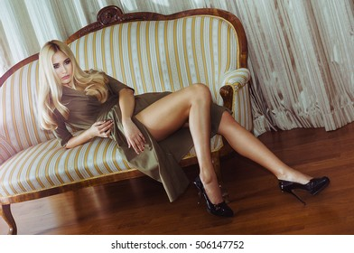 Young beautiful woman lying on the sofa