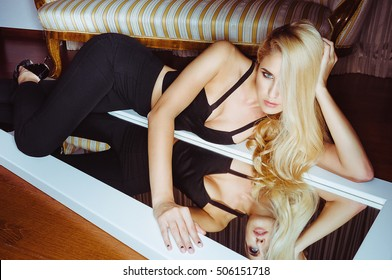 Young beautiful woman lying on the mirror