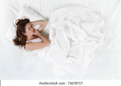 young beautiful woman lying on the bed.