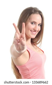 Young beautiful woman making victory or peace gesture isolated on a white background