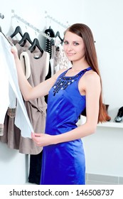 young Beautiful woman in mall buying clothes