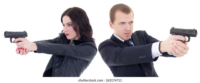 young beautiful woman and man shooting with guns isolated on white background