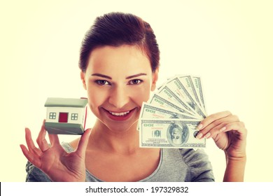 Young beautiful woman with money and house