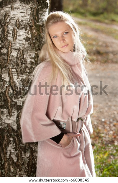 Young beautiful woman near birch
