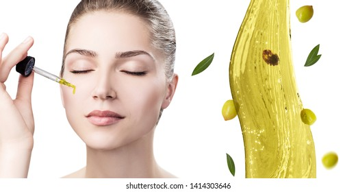 Young beautiful woman near splash of olive oil. Skincare concept. Isolated on white background.