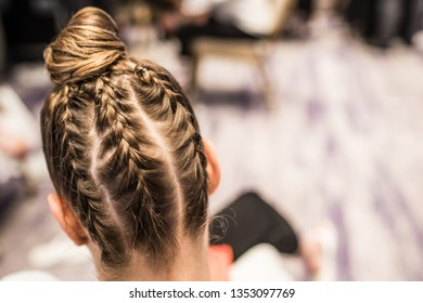 Young beautiful woman with nice braid hairstyle.