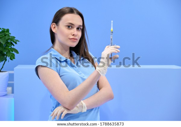 Young Girl Nurse With A Syringe Stock Photo - Image of
