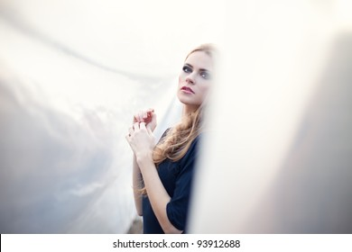 young beautiful woman on abstract background