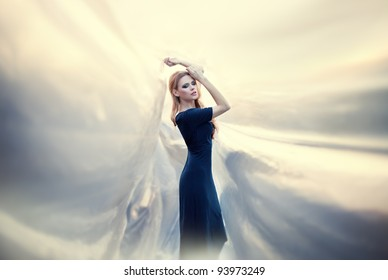 young beautiful woman on abstract background. Soft sunny colors