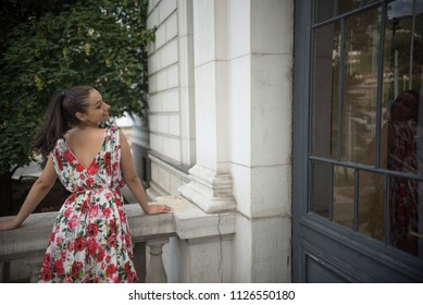 young beautiful woman on balcony