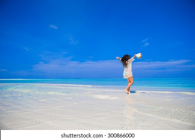 Young beautiful woman on beach during tropical vacation