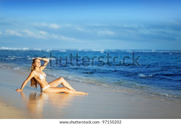 young beautiful woman on the beach