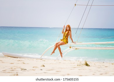 young beautiful woman on board of sea yacht, tropical sea background