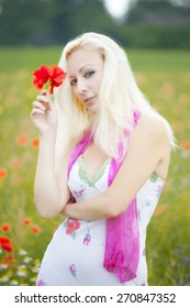 young beautiful woman on the flower field
