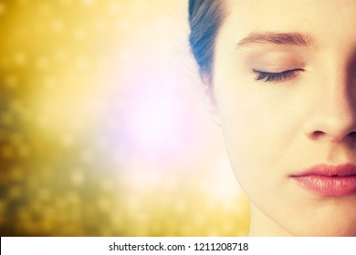 Young beautiful woman on glossy golden background