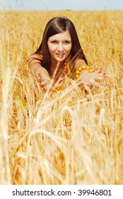 Young beautiful woman on plant of wheat