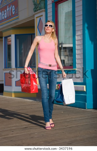 A young beautiful woman on a shopping spree