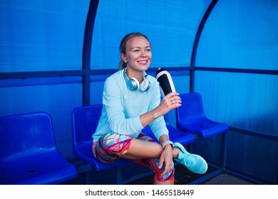 young beautiful woman on stadium - after workout