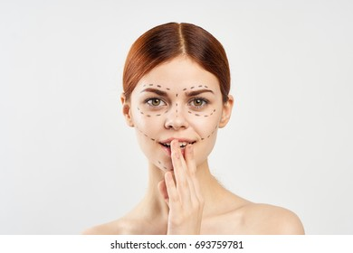 Young beautiful woman on white isolated background, plastic surgery, facial contour.