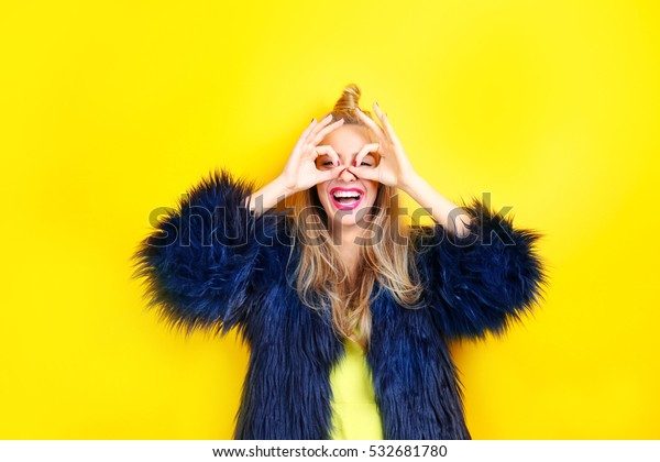 Young beautiful woman on yellow background