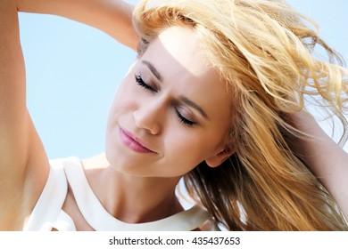 Young beautiful woman outdoors