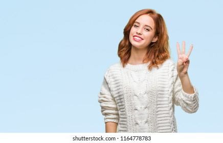 Young beautiful woman over isolated background wearing winter sweater showing and pointing up with fingers number three while smiling confident and happy.