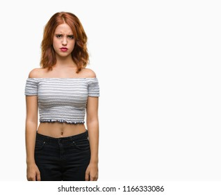 Young beautiful woman over isolated background skeptic and nervous, frowning upset because of problem. Negative person.