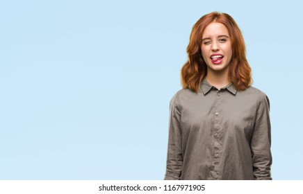 Young beautiful woman over isolated background sticking tongue out happy with funny expression. Emotion concept.