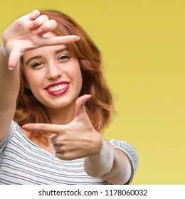 Young beautiful woman over isolated background smiling making frame with hands and fingers with happy face. Creativity and photography concept.