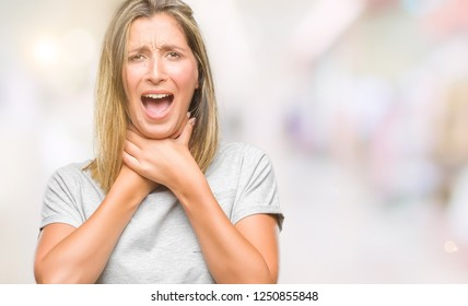 Young beautiful woman over isolated background shouting and suffocate because painful strangle. Health problem. Asphyxiate and suicide concept.