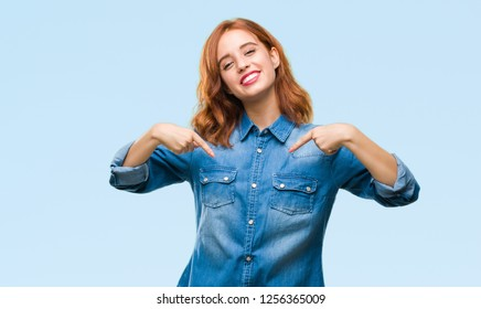 Young beautiful woman over isolated background looking confident with smile on face, pointing oneself with fingers proud and happy.