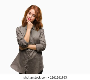 Young beautiful woman over isolated background with hand on chin thinking about question, pensive expression. Smiling with thoughtful face. Doubt concept.